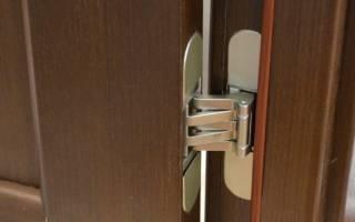 Как отрегулировать петли на дверцах кухонного шкафа?